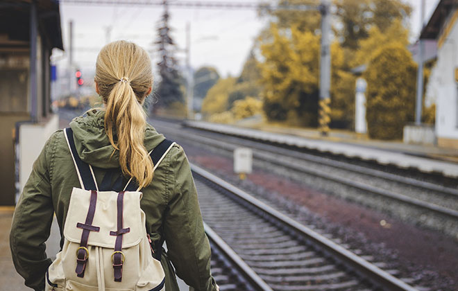 Girl walking on a train platform