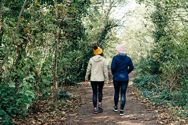Two woman walking along a path